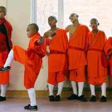 Young Shaolin monks warm-up before a performance, London