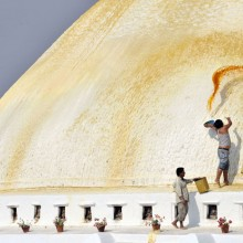 Painting a stupa in Boudhanath, Nepal