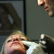 Plastic surgeon injects Botox, London